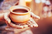 stock photo of experiments  - Pottery Craft Ceramic Clay In Potter Human Hand - JPG