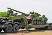 stock photo of armored car  - Shot of a russian military tank T72 on auto trailer - JPG