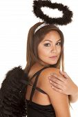 image of halo  - A close up of a woman in her black angel costume with wings and a halo - JPG