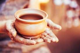 foto of pottery  - Pottery Craft Ceramic Clay In Potter Human Hand - JPG
