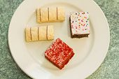 pic of jimmy  - Assortment of sweet and colorful dessert cakes on a plate - JPG