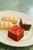 foto of jimmy  - Assortment of sweet and colorful dessert cakes on a plate - JPG