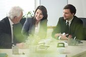 stock photo of debate  - Three businesspeople during debate in conference room - JPG