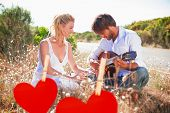 stock photo of serenade  - Handsome man serenading his girlfriend with guitar against hearts hanging on a line - JPG