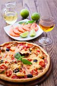 stock photo of hot fresh pizza  - Delicious fresh pizza with seafood on wood table - JPG