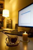 stock photo of field mouse  - Computer and cup of tea on white desk. ** Note: Shallow depth of field - JPG