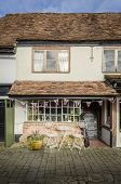 image of quaint  - Quaint old fashioned English tea rooms with Union Jack bunting - JPG