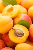 foto of apricot  - Background of fresh ripe apricots. With leaf.