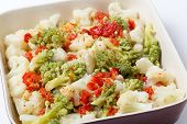 stock photo of romanesco  - Italian style Cauliflower and romanesco salad with grilled bell pepper and  a lemon - JPG
