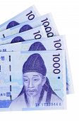 pic of won  - Several Korean 1000 Won currency bills isolated on a white background - JPG