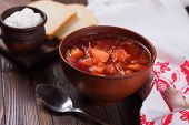 pic of vegetable soup  - Fresh appetizing vegetable soup borscht with potato carrot onion tomato beetroot in bowl on table - JPG