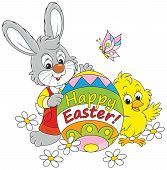 stock photo of cony  - Little rabbit and chicken holding a colorfully colored Easter egg - JPG