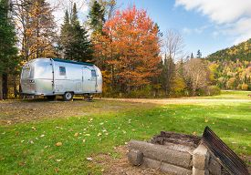 stock photo of caravan  - Retro style stainless steel caravan in American outdoors - JPG