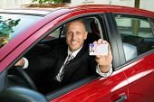picture of car-window  - Portrait Of A Young Businessman Showing His Driving License From Open Car Window - JPG
