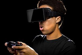 foto of controller  - Virtual Reality headset on a black male with video game controller - JPG