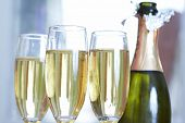 stock photo of champagne glass  - Champagne and glass - JPG