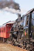 stock photo of chug  - a steam train chugging through hawke - JPG