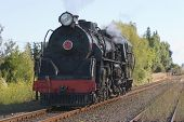 stock photo of chug  - a steam train chugging through hawke - JPG