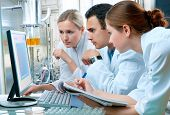 stock photo of scientist  - group of scientists or students working at the laboratory - JPG