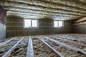 House Attic Under Construction. Mansard Walls And Ceiling Insulation With Rock Wool. Fiberglass Insu poster