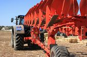Details Of A Modern Combine Harvester Close-up. Modern Combine Harvester Works In The Field. Sowing poster