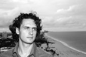Man With Curly Brunette Hair On Seascape Background In Fort Lauderdale, Usa. Macho And Sea Beach. To poster