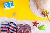 May 7th. Image Of May 7 Calendar With Summer Beach Accessories. Spring Like Summer Vacation Concept. poster