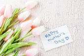 Mothers Day Concept, Greeting Card Background. Flowers Tulips And Greeting Note Happy Mothers Day  poster