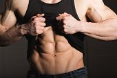 Perfect Man Shows His Six Pack Abs. Muscular And Fit Torso Of Young Male. Hunk With Athletic Body Ho poster