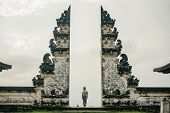 A Man In Traditional Clothes Passes Through The Gate Looking Back. Ancient Gate In Pure Lempuyan, Ba poster