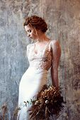 Blonde Bride In Fashion White Wedding Dress With Makeup. Wedding Day Of Bride In Bridal Gown. Beauty poster