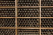 stock photo of wine bottle  - Wine rack filled with bottles of vintage wine - JPG