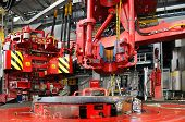 pic of oil rig  - top drive and torque master on the rig floor - JPG