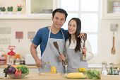 Portrait Of Happy Young Couple Cooking Together In The Kitchen.lover Hobby Lifestyle Concept. poster
