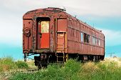 stock photo of railcar  - Rusted and worn out an old passenger railcar sits on a rail siding - JPG