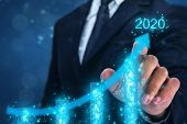 2020 Concept,business Man Point Hand On The Top Of Arrow Graph With High Rate Of Growth In Year 2020 poster