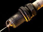 Old Worn Spark Plug With High Voltage Spark poster