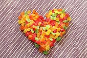 Heart Made Of Dried Candied Fruits On Table Background. Colorful Candied Fruits Succade Assorted Can poster