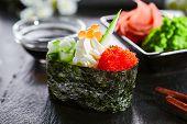 Delicious gunkan with cucumber and masago caviar. Japanese cuisine restaurant menu item. Traditional poster