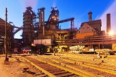 stock photo of blast-furnace  - Blast furnace equipment of the metallurgical plant at night - JPG