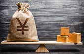 Yen Yuan Symbol Money Bag And A Bunch Of Boxes On Scales. Trade Exchange Balance. Import And Export, poster