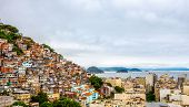 Brazilian Favelas On The Hill With City Downtown Below At The Tropical Bay, Rio De Janeiro, Brazil poster