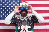 Party Like Patriot. Happy Santa Make Glasses With Balls. Bearded Man Enjoy Santa Claus Party. Patrio poster