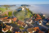 Aerial View Of Warm Sunrise Over A Typical Foggy Swiss Medieval Town Waltalingen. Hilltop Castle Sch poster