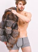Guy Attractive Posing Fur Coat On Naked Body. Luxury Lifestyle And Wellbeing. Luxury Status Symbol.  poster