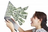foto of indian money  - Young woman with laptop and money in great on - JPG
