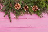 Pink Christmas Background With Natural Decor. Top Border From Fresh Fir Branches, Pine Cones And Whi poster