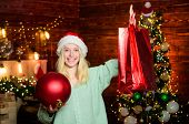Winter Shopping. Package With Purchase. Girl Hold Ball To Decorate Interior. Merry Christmas. Glamor poster