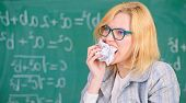 Thirst Of Knowledge. Woman Teacher Eats Crumpled Piece Of Paper Chalkboard Background. Teacher Eats  poster
