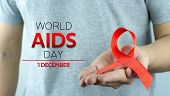 Aids Awareness, Male Hands Holding Red Aids Awareness Ribbon. World Aids Day, Healthcare And Medical poster